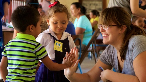 teacher interacting with young children