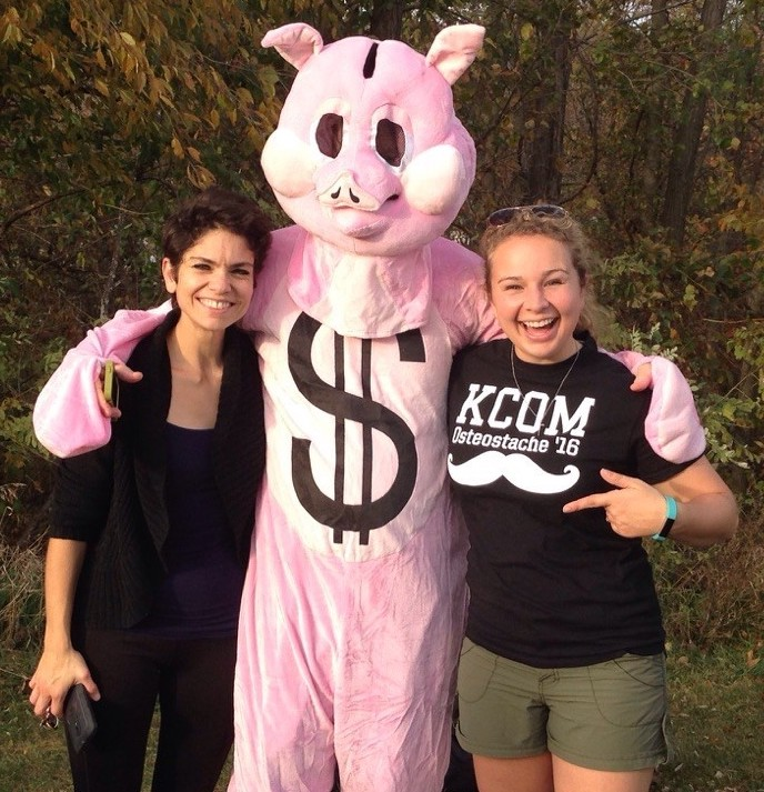 A KCOM faculty member in a pig suit.