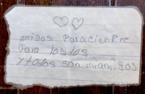 "Handwritten note from Samantha reads, ""amigos para siem­pre para los dos y todos son mi amigos"" (Friends forever you and me and you all are my friends)"