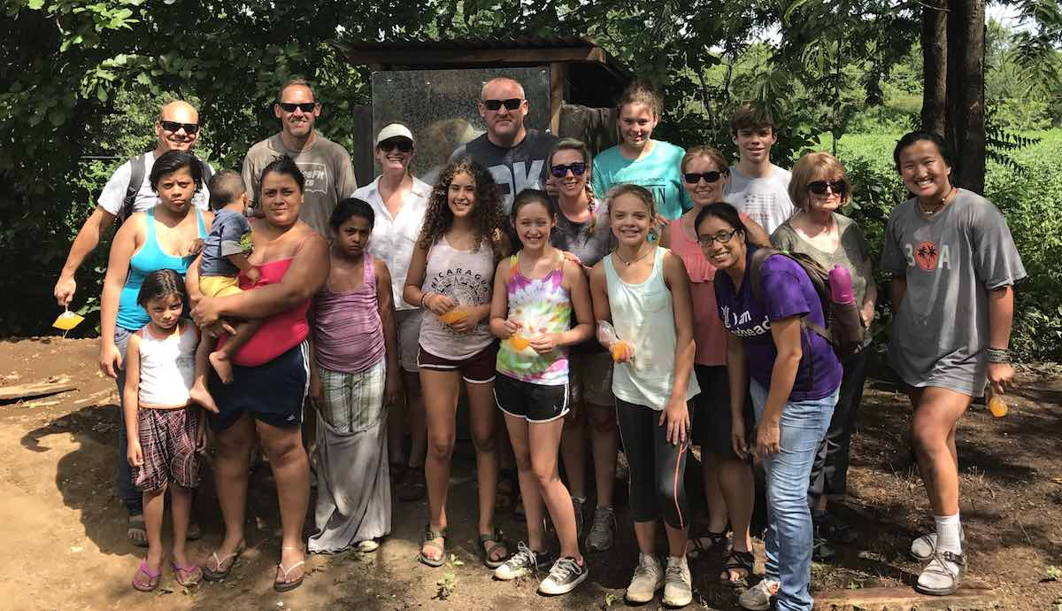 a US Partner group posing with a Nicaraguan family