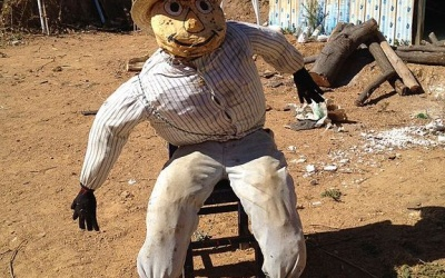 a scarecrow-like effigy waiting to burn away the old year past